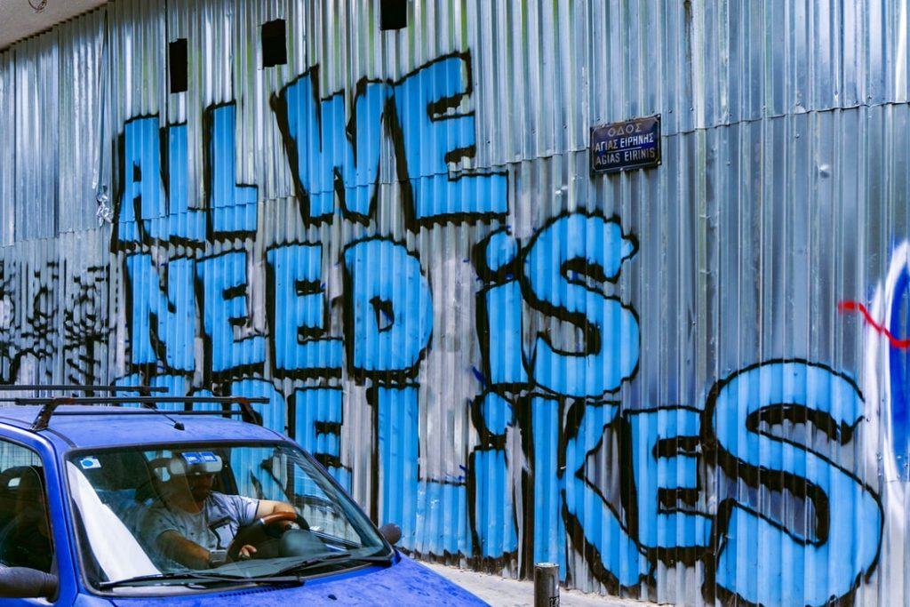 тенденции соцсетей. All we need is more likes - надпись-граффити